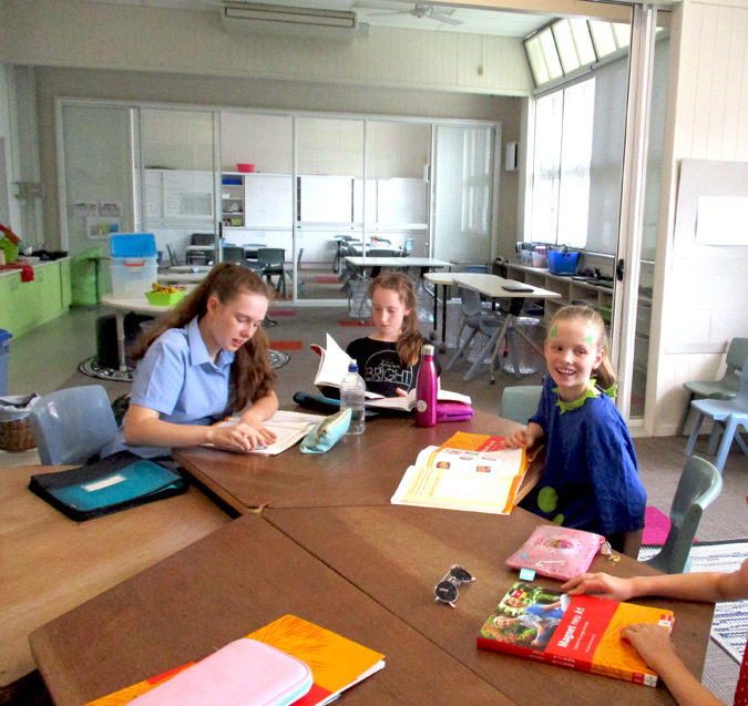 Students sitting in a classroom studying German at a school in South Brisbane.