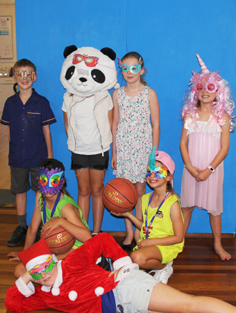 children wearing masks and costumes